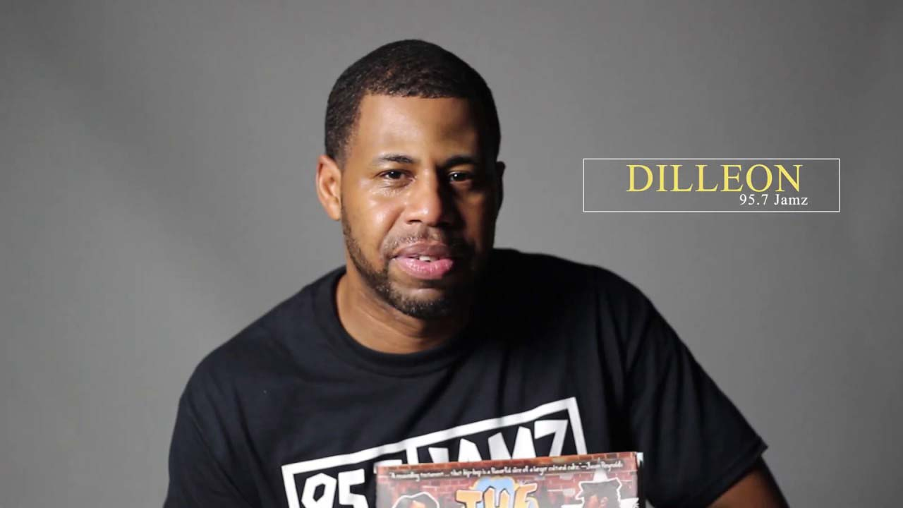 "Dilleon from 95.7 Jamz reads  ""The Roots of Rap""  by Carole Boston Weatherford"